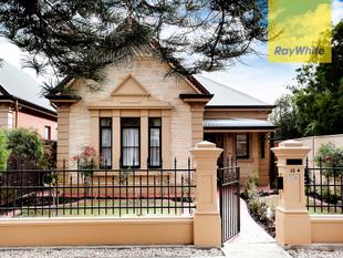 Set amongst the Norfolk Island pines in Reedie Street. - Henley Beach